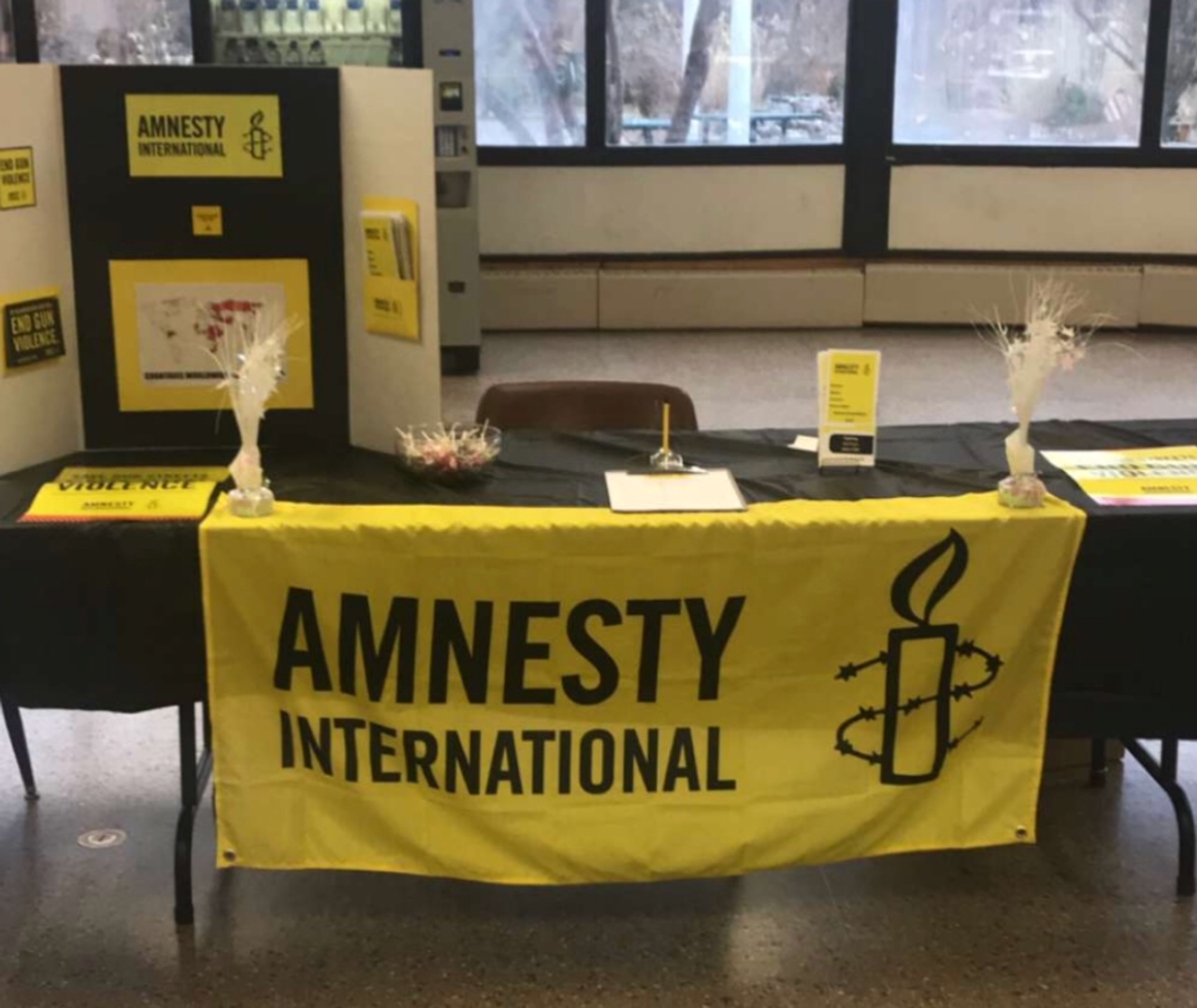 Pictured here is the Amnesty table set up in the rotunda, to encourage registration for the club.