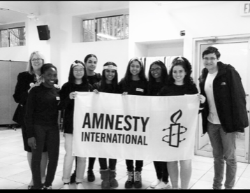 Pictured here is the board and other members of Amnesty International. From  left to right: Joy Oghenekome, Hope Li, Manahil Khan, Jenna Johnson, Sabia Akand, Emily Bridglall, Isabella Abbamonte, Robert Hager
