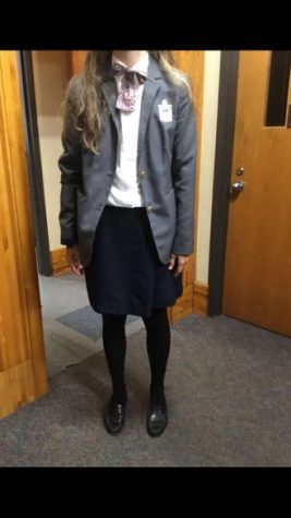 Kellenberg Student in their School Uniform which includes Blazer