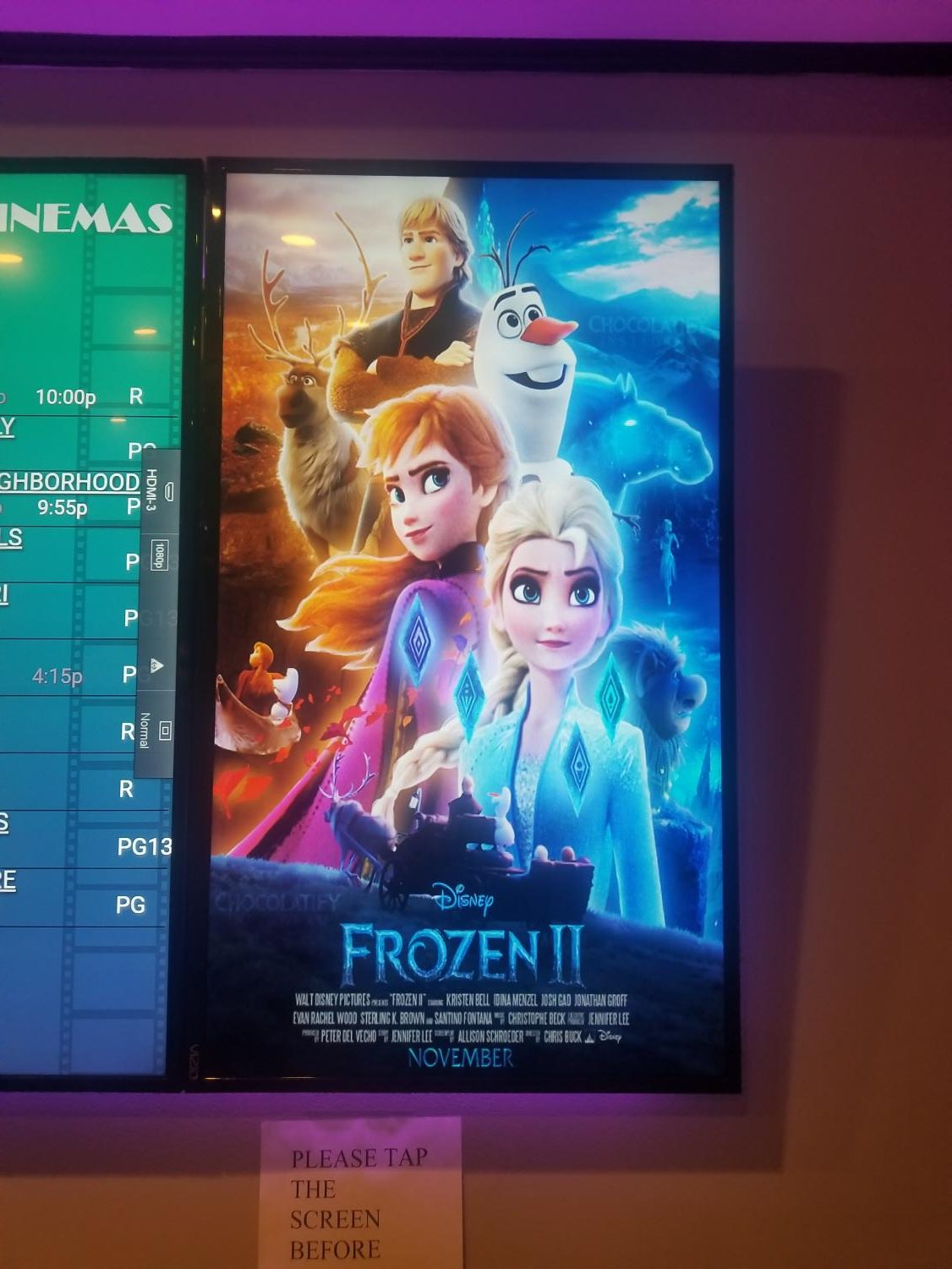 The movie poster at the theater.