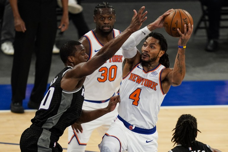 Feb 25, 2021; New York, New York, USA; New York Knicks guard Derrick Rose (4) shoots against Sacramento Kings forward Harrison Barnes (40) in the second half at Madison Square Garden. Mandatory Credit:  John Minchillo/POOL PHOTOS-USA TODAY Sports